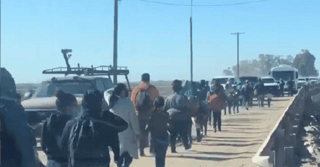 WATCH: Parade of Migrants Stream Across Border into Arizona 1