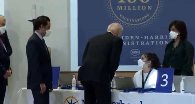 Joe Biden Leans Forward and Whispers to Women at Check-in Desk at Vaccination Site in Virginia (VIDEO) 1