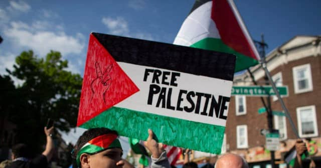 Michigan Public School Defends Allowing Student to Display 'Free Palestine' Flag at Graduation 1